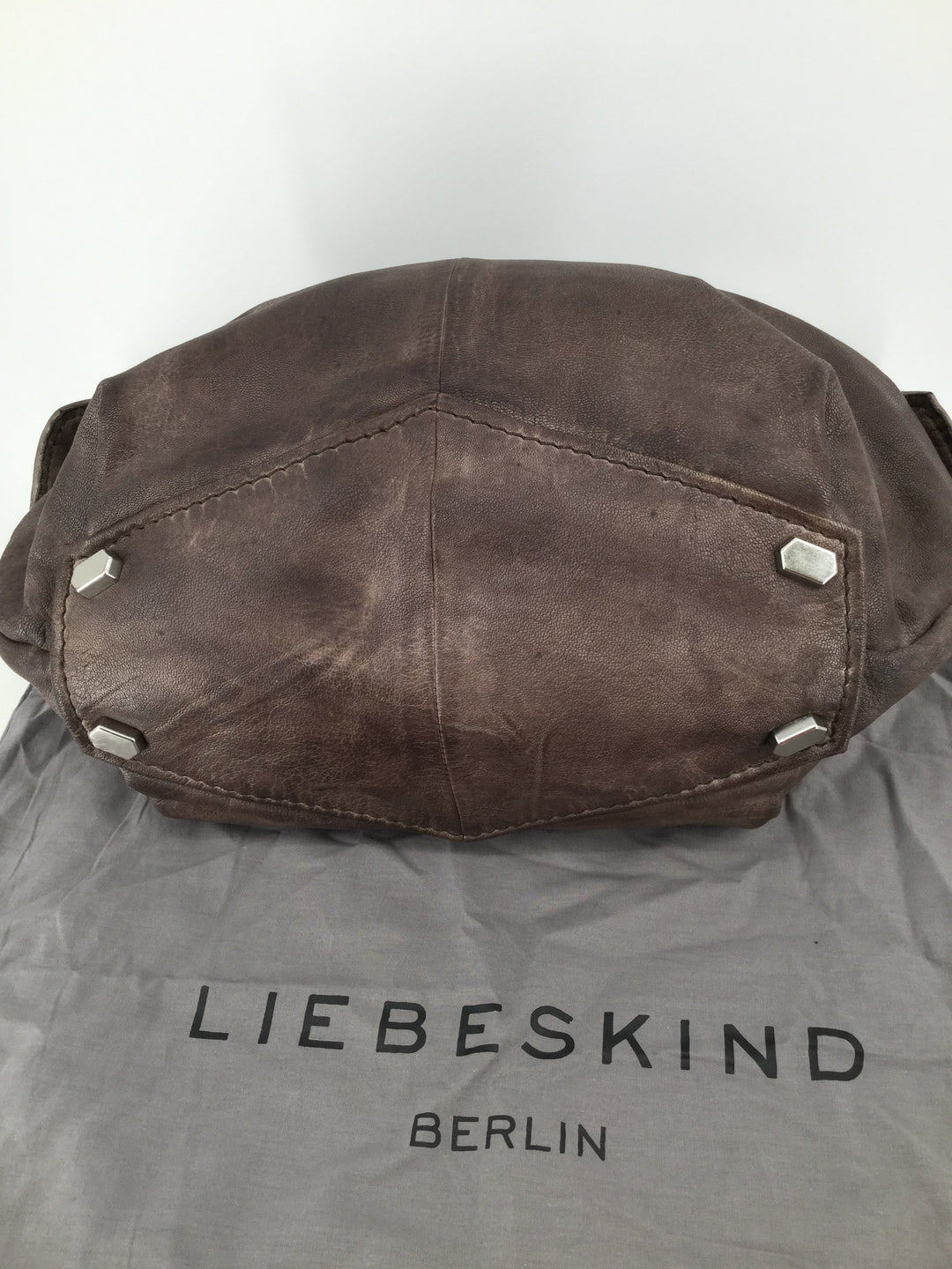 Liebeskind Handbag, Bronze, Size Medium - <P>THIS GENTLY WORN LIEBESKIND HANDBAG IS BEAUTIFUL INSIDE AND OUT. MEASURES 10 INCHES TALL AND 19 INCHES WIDE. COMES WITH SLEEPER BAG. MAKE HER YOURS FOR ONLY $80.</P>
