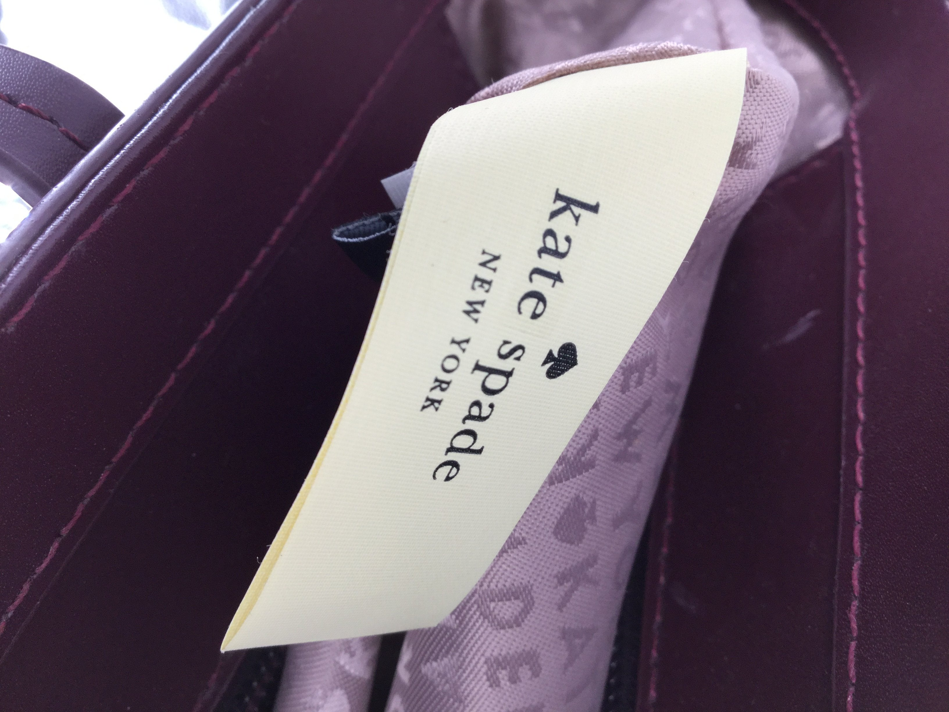 Kate Spade Designer Handbag, Maroon, Size Large - <P>EVERY GIRL NEEDS A KATE SPADE HANDBAG, CHECK OUT THIS BEAUTIFUL LARGE MAROON BAG. NO POCKETS ON THE INSIDE. MINOR WEAR ON THE BOTTOM OF BAG, (SEE PHOTOS).</P>