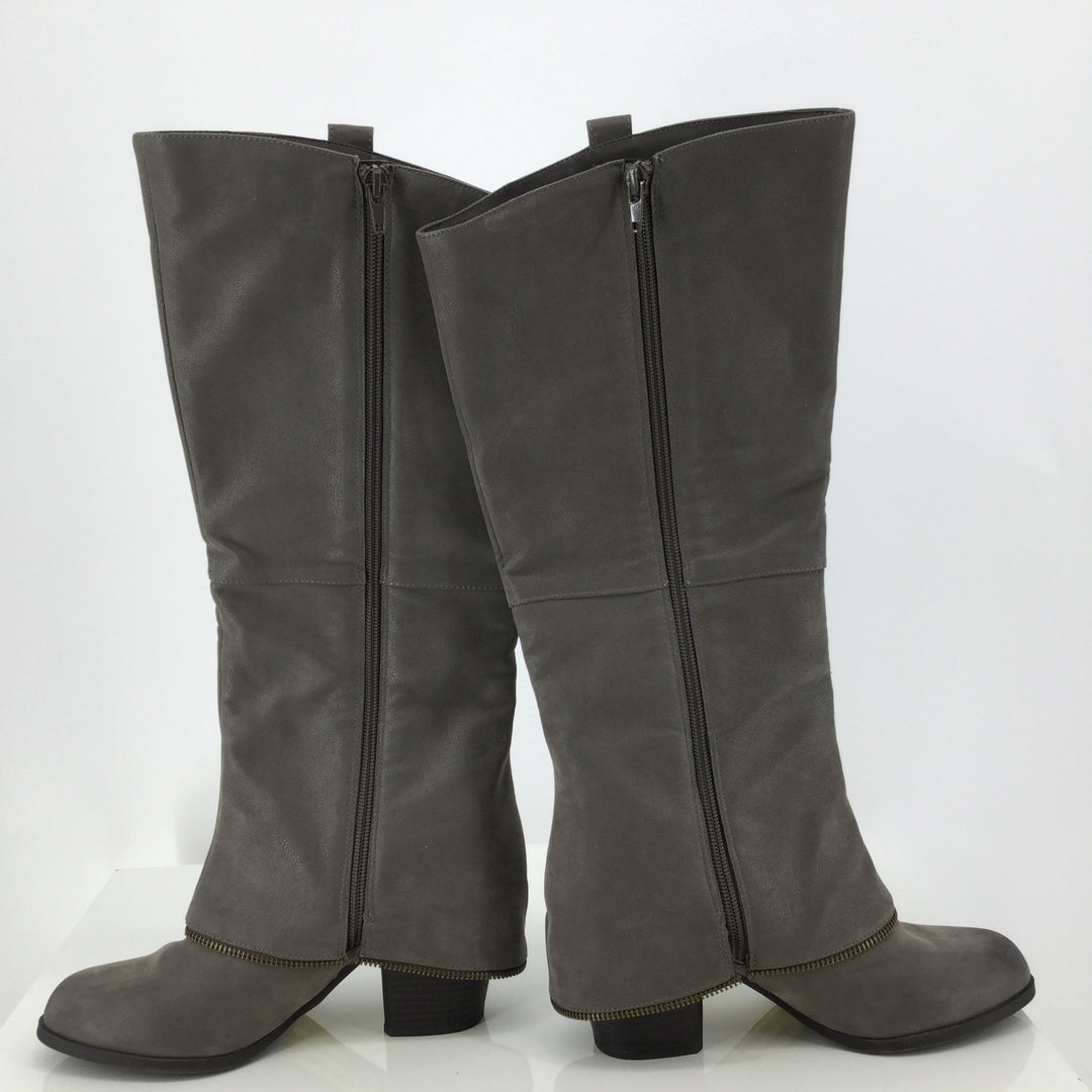 Fergalicious Grey Knee Boots Size: 8.5 - <P>THESE FERGALICIOUS BOOTS WOULD LOOK GREAT WITH ANY OUTFIT! THEY HAVE A DECORATIVE ZIPPER ON THE OUTSIDE AND A FUNCTIONING ZIPPER ON THE INNER SIDE OF THE BOOT. THEY ARE A GREY SIZE 8.5 WITH GOLD ZIPPERS. THEY ARE VERY GENTLY USED AND LOOK LIKE THEY HAVE NOT BEEN WORN MUCH.</P>