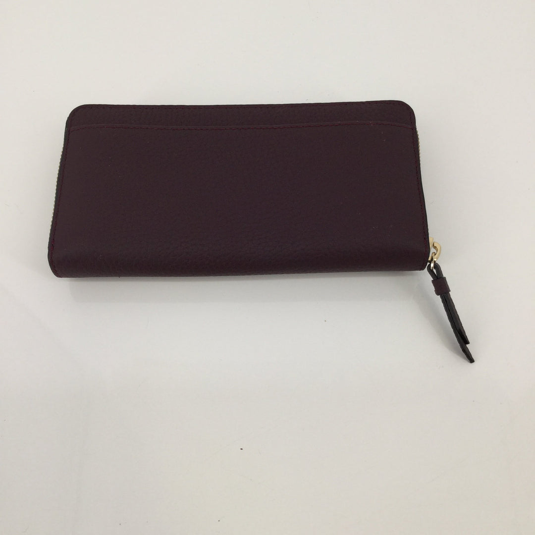 Kate Spade Plum Wallet Size Medium - <P>THE GEMSTONE DETAILS ON THIS KATE SPADE WALLET ARE SO CLASSY! THE WALLET IS PLUM COLORED AND THE STONES ARE BLACK. INSIDE THERE IS PLENTY OF STORAGE SPACE. THERE ARE LOTS OF CARD SLOTS AND A ZIPPER POCKET. THIS WALLET IS GENTLY USED. THERE IS SOME MINOR WEAR ON THE BACK (SEE PHOTOS).</P>