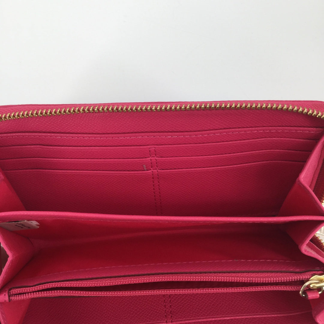 Coach Pink Leather Wallet - <P>THIS COACH WALLET FEATURES THE CLASSIC COACH PATTERN. IT IS BROWN WITH A PINK OUTLINE. INSIDE THERE IS LOTS OF ROOM FOR STORAGE! IT HAS LOTS OF CARD SLOTS AND A ZIPPER POCKET. THIS WALLET IS IN GREAT CONDITION AND LOOKS LIKE IT HAS NOT BEEN USED MUCH.</P>