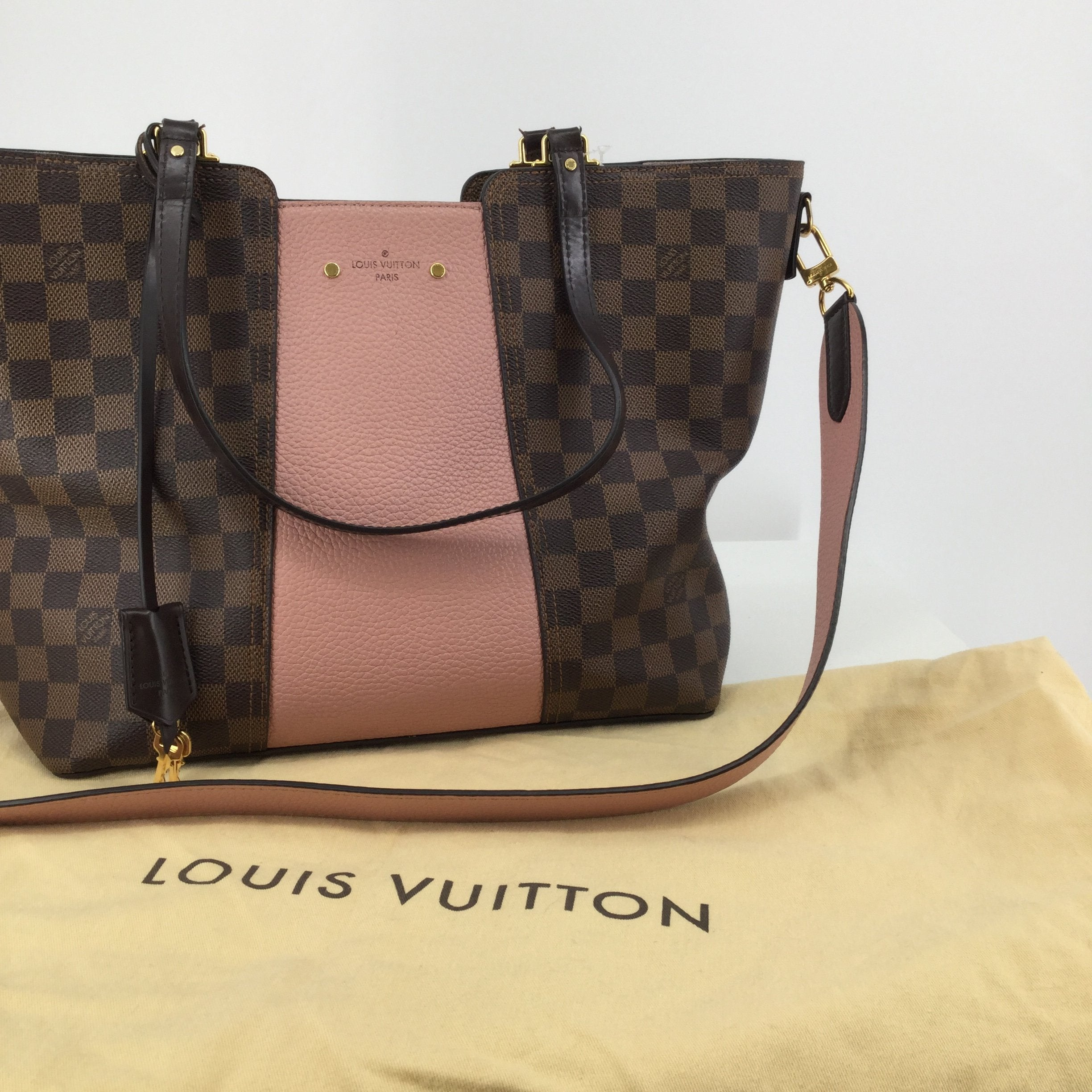 Louis Vuitton Brown Leather Ebene Jersey Magnolia Tote - <P>EVERY GIRL NEEDS A LOUIS VUITTON! THIS BEAUTIFUL BAG COMES WITH A CERTIFICATE OF AUTHENTICITY FROM ENTRUPY! IT IS PINK AND BROWN ON THE OUTSIDE AND THE INTERIOR IS LIGHT PINK. INSIDE THE BAG THERE ARE SEVERAL SLIP POCKETS FOR STORAGE. IT COMES WITH SHOULDER STRAPS AND A REMOVABLE CROSSBODY STRAP. THE OUTSIDE OF THIS BAG IS IN GREAT CONDITION WITH LITTLE TO NO WEAR. THE INSIDE IS GENTLY USED WITH SOME MINOR WEAR (SEE PHOTOS). SLEEPER BAG INCLUDED.</P>