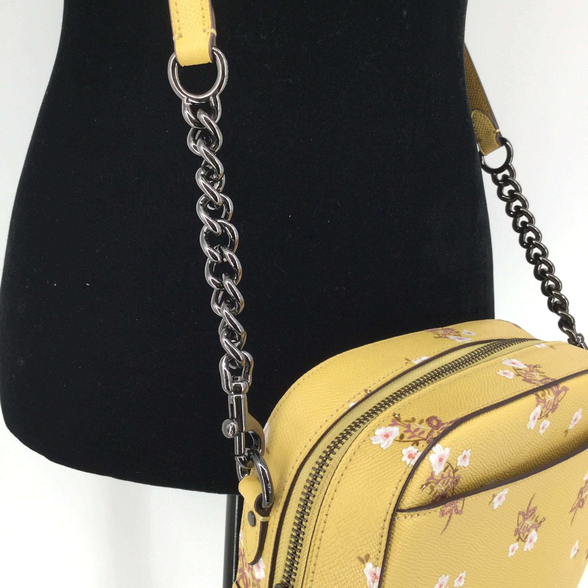 Coach Yellow Leather Designer Handbag - <P>THIS COACH IS THE PERFECT SPRING BAG! IT IS YELLOW WITH A FLORAL PATTERN. THERE IS A SLIP POCKET ON THE FRONT AND THE BACK. THE CROSSBODY STRAP IS REMOVABLE. INSIDE, THERE IS A SLIP POCKET AND A ZIPPER POCKET. THERE IS A SLEEPER BAG INCLUDED! THIS BAG IS GENTLY USED WITH SOME MINOR WEAR ON THE BACK (SEE PHOTOS).</P>