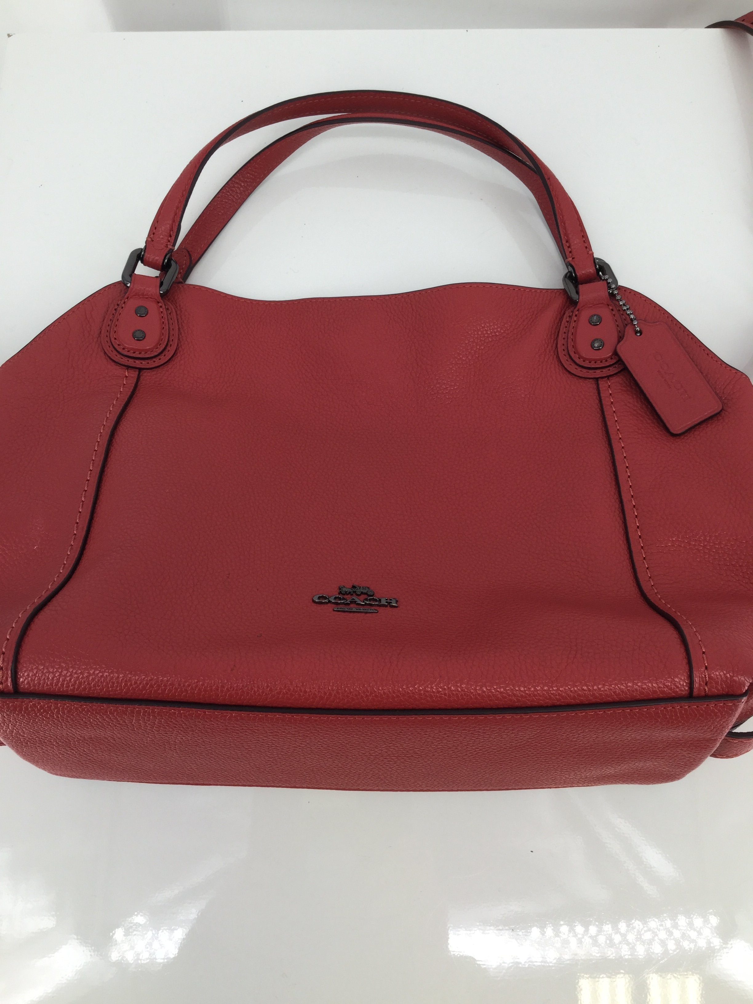Coach Salmon Leather Designer Handbag - <P>THIS SALMON COLORED COACH HANDBAG IS BEAUTIFUL! THE OUTSIDE OF THIS BAG IS IN VERY GOOD CONDITION WITH VERY LITTLE WEAR. INSIDE, THERE ARE SOME INK STAINS (SEE PHOTOS). THIS BAG HAS SHOULDER STRAPS AND A REMOVABLE CROSSBODY STRAP.</P>