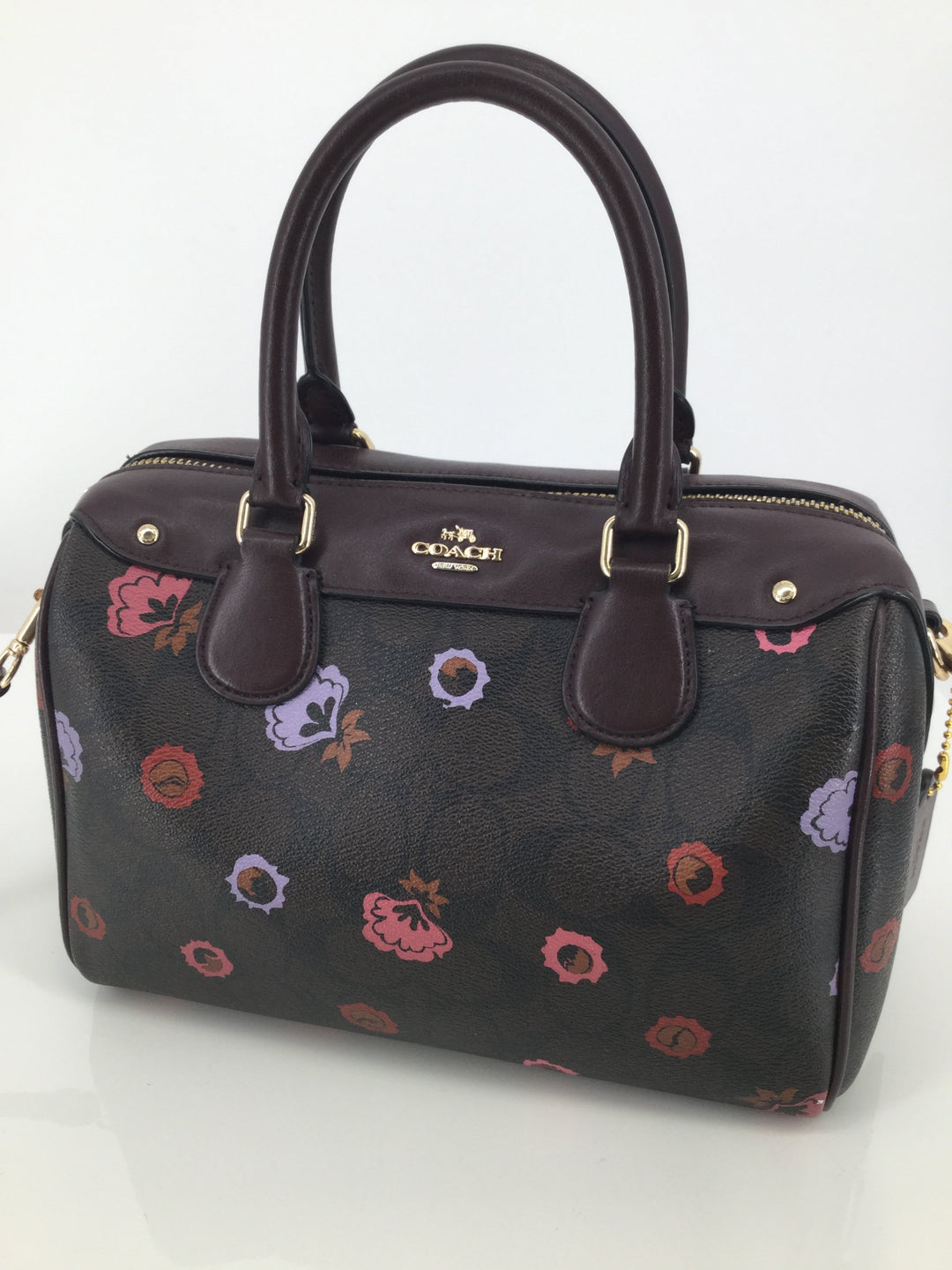 Coach Brown And Burgundy Small Leather Handbag - <P>THIS COACH BAG IS BROWN WITH BURGUNDY AT THE TOP AND ON THE STRAPS. THERE ARE SHOULDER STRAPS AND A REMOVABLE CROSSBODY STRAP. INSIDE, THERE IS A SLIP POCKET AND A ZIPPER POCKET. THIS BAG IS IN GOOD CONDITION WITH VERY LITTLE WEAR (SEE PHOTOS FOR MORE DETAILS).</P>