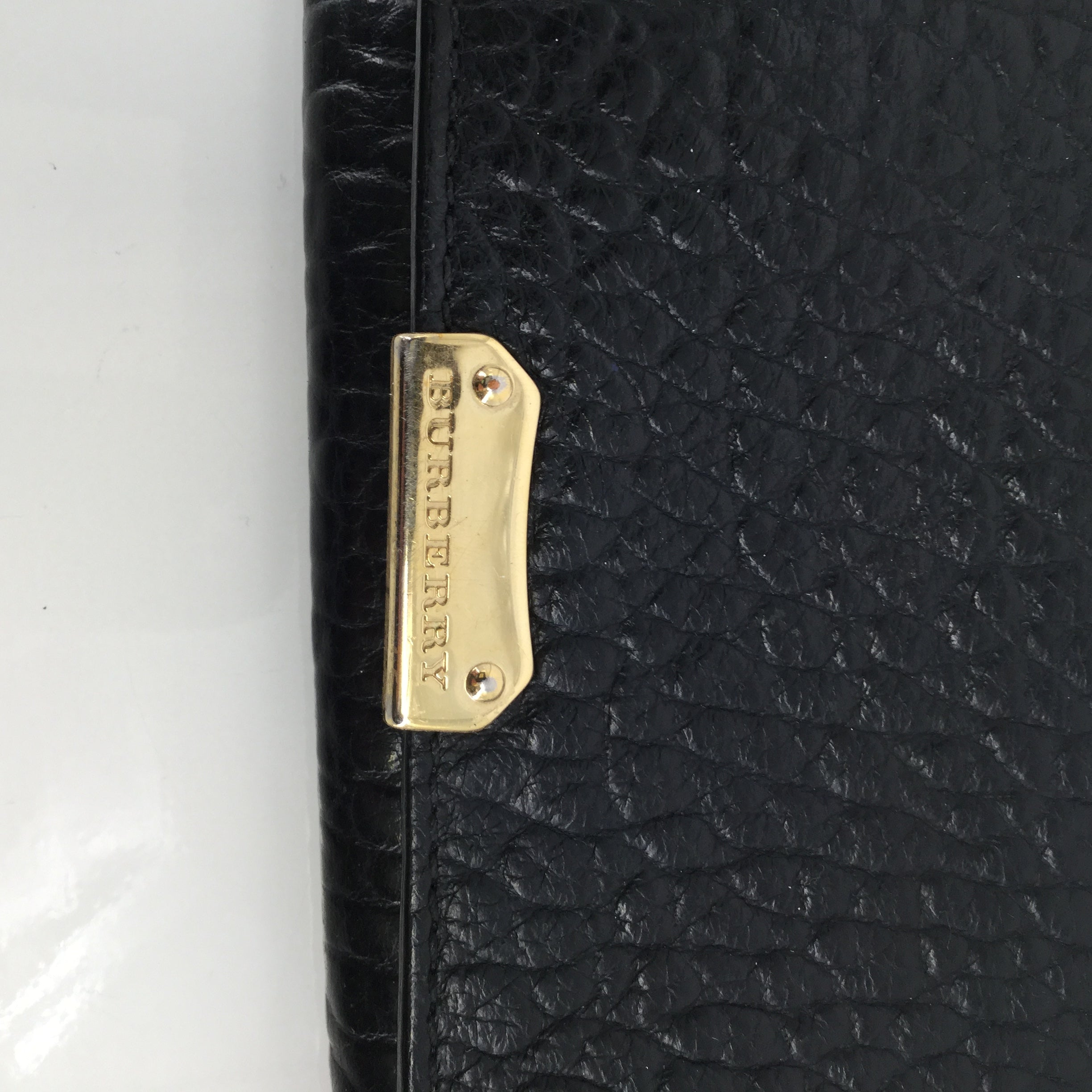 Wallet By Burberry  Size: Small - <P>BRAND: BURBERRY , STYLE: WALLET , COLOR: BLACK , SIZE: SMALL , SKU: 127-4942-2331</P> <P>THIS BURBERRY WALLET IS VERY GENTLY USED AND IN GREAT CONDITION. IT HAS SEVERAL CARD SLOTS AND SPACE FOR BOTH CHANGE AND CASH. </P>