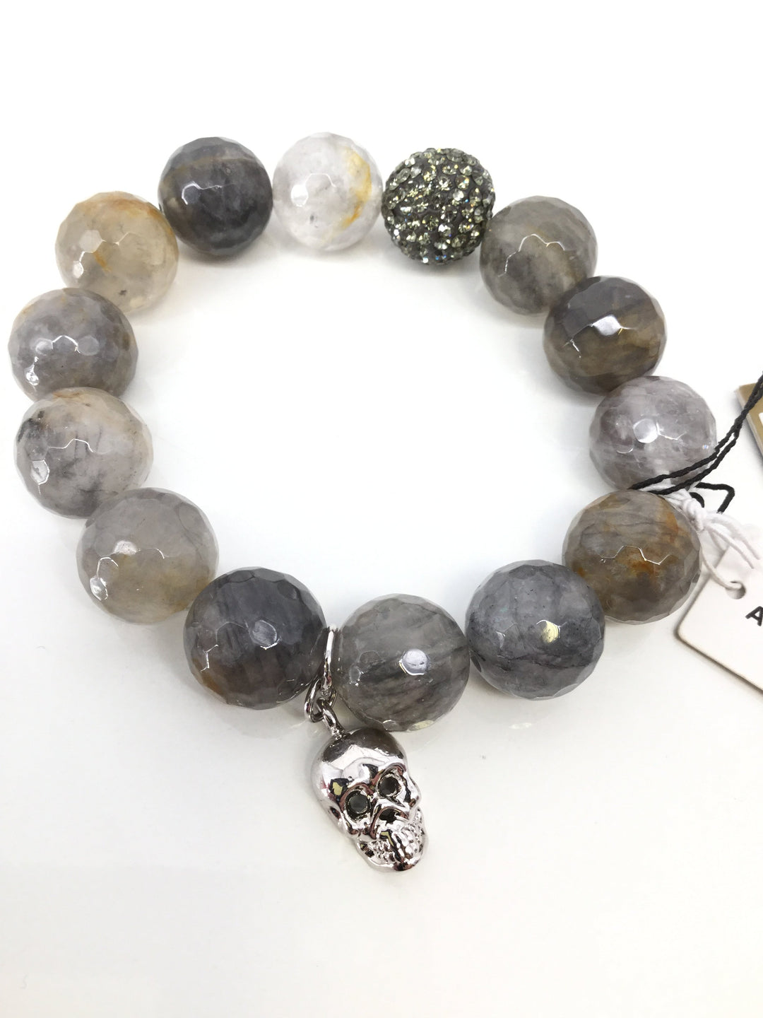 NEW! Nordstrom Bracelet - <P>NEW WITH TAGS! EARTH TONE GENUINE AGATE STONE AND AUSTRIAN CRYSTAL BRACELET. SILVER RHINESTONE BEAD AND SILVER SKULL CHARM.</P>