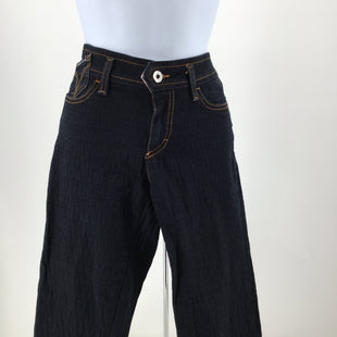Dolce And Gabbana Jeans, Denim, Blue, Size: 2 - THESE DOLCE AND GABBANA SKINNY JEANS HAVE A 26 INCH WAIST. THEY ARE A DARK BLUE WASH WITH A SUBTLE D&G PRINT. THERE ARE ZIPPERS AT THE BOTTOM OF EACH PANT LEG. THEY ARE IN VERY GOOD CONDITION AND DO NOT LOOK LIKE THEY HAVE BEEN WORN MUCH.