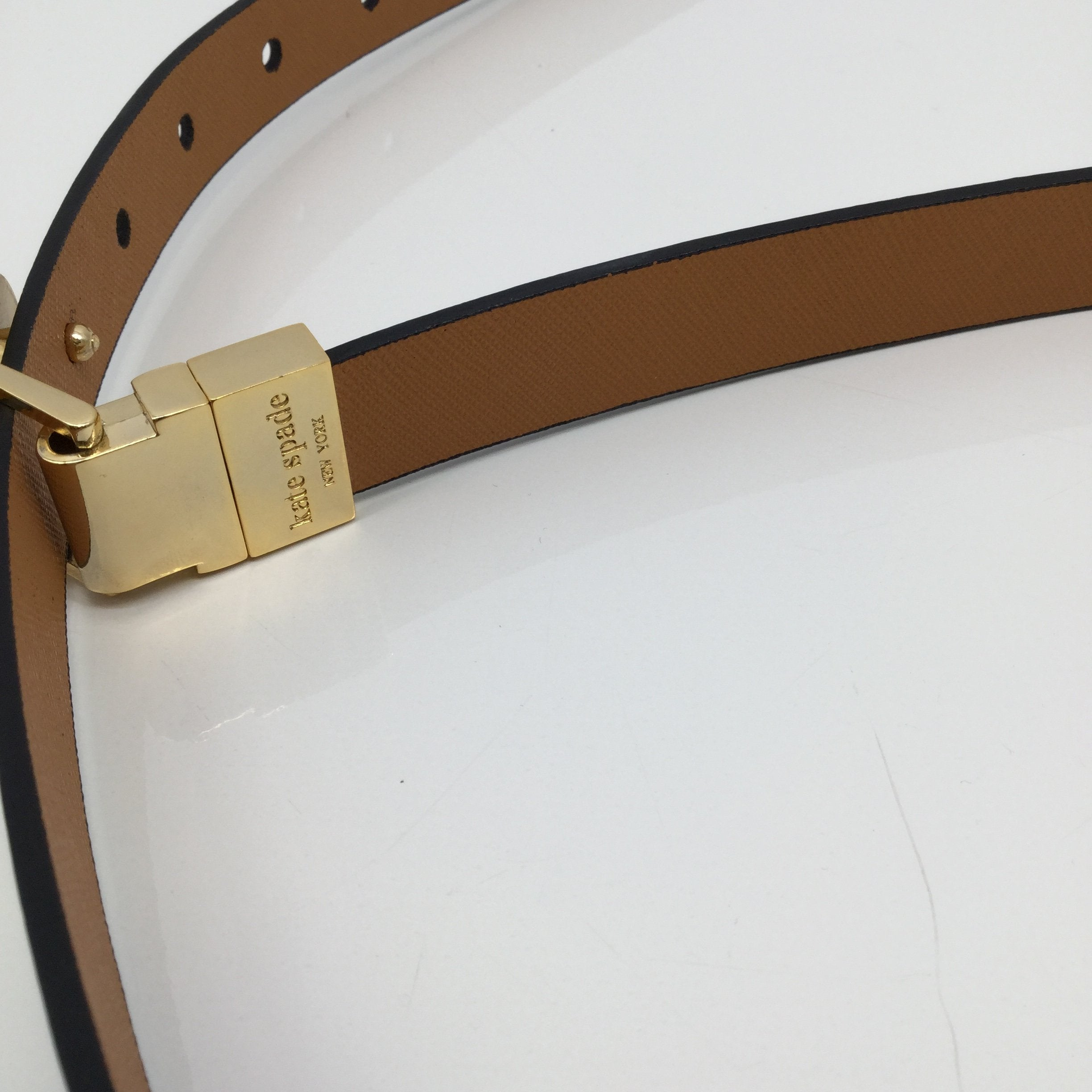 Kate Spade Belt Size Large - <P>VERY GREAT CONDITION ADJUSTABLE GOLD KATE SPADE BELT. MAKE IT YOURS TODAY FOR ONLY $25</P>