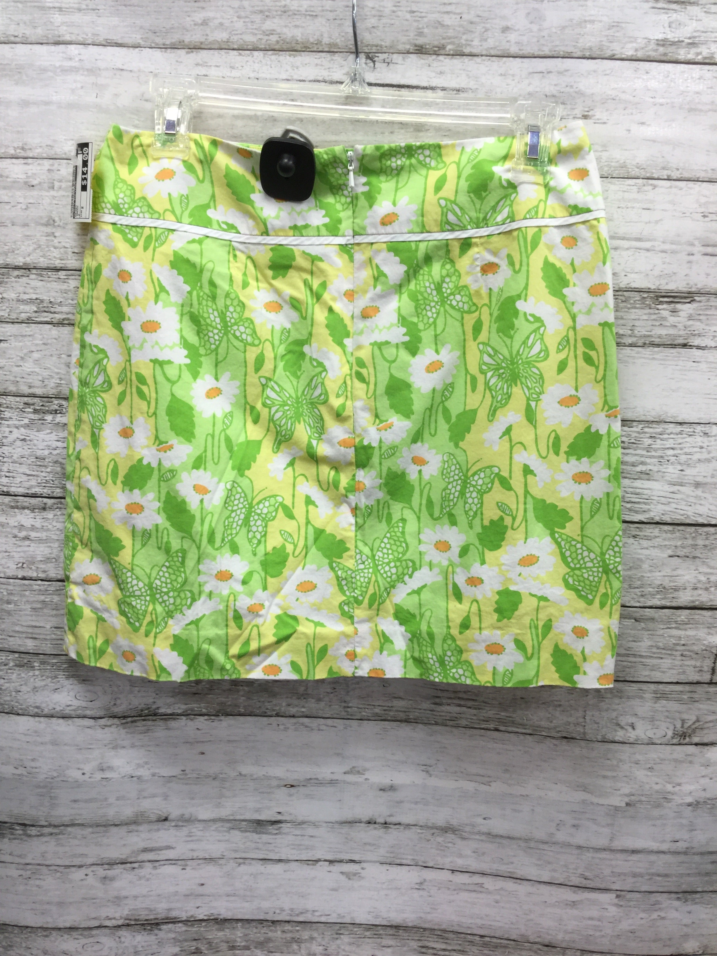 Photo #1 - BRAND: LILLY PULITZER , STYLE: SKIRT , COLOR: GREEN , SIZE: 2 , SKU: 127-3371-45721, , LILLY PULITZER SKIRT IN THE CUTEST PASTEL GREEN, YELLOW, ORANGE AND WHITE PRINT WITH FLOWERS AND BUTTERFLIES! FEATURES WHITE TRIM AND BOW DETAIL.