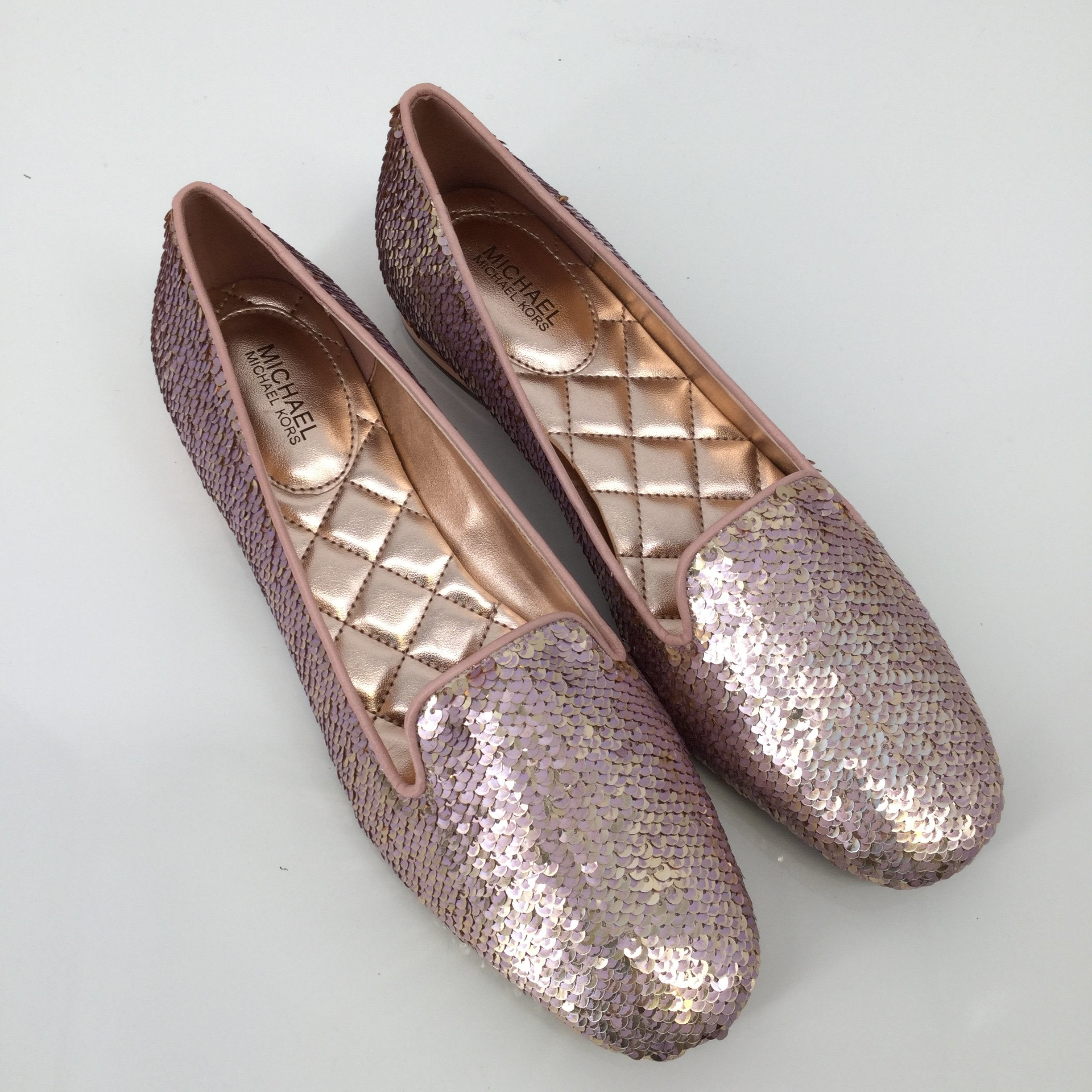 Michael By Michael Kors Flats, Sequin, Pink, Size:8 - <P>THESE SPARKLY MICHAEL BY MICHAEL KORS FLATS ARE THE PERFECT SHOE TO SPICE UP ANY OUTFIT! THEY ARE IN GREAT CONDITION AND LOOK LIKE THEY HAVE NEVER BEEN WORN. THEY ARE PINK ON THE OUTSIDE AND ROSE GOLD INSIDE.</P>