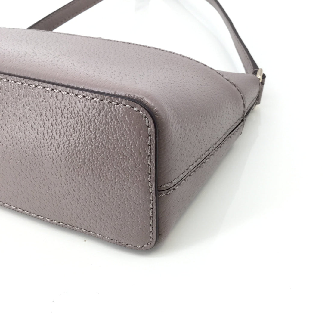 Small Leather Kate Spade Handbag NEW!  - <P>NEW WITH TAGS! SMALL LEATHER KATE SPADE CROSS-BODY WITH GOLD DETAILING. TAUPE IN COLOR WITH ADJUSTABLE STRAP. GREY INTERIOR WITH SIGNATURE KATE SPADE PATTERN.</P>