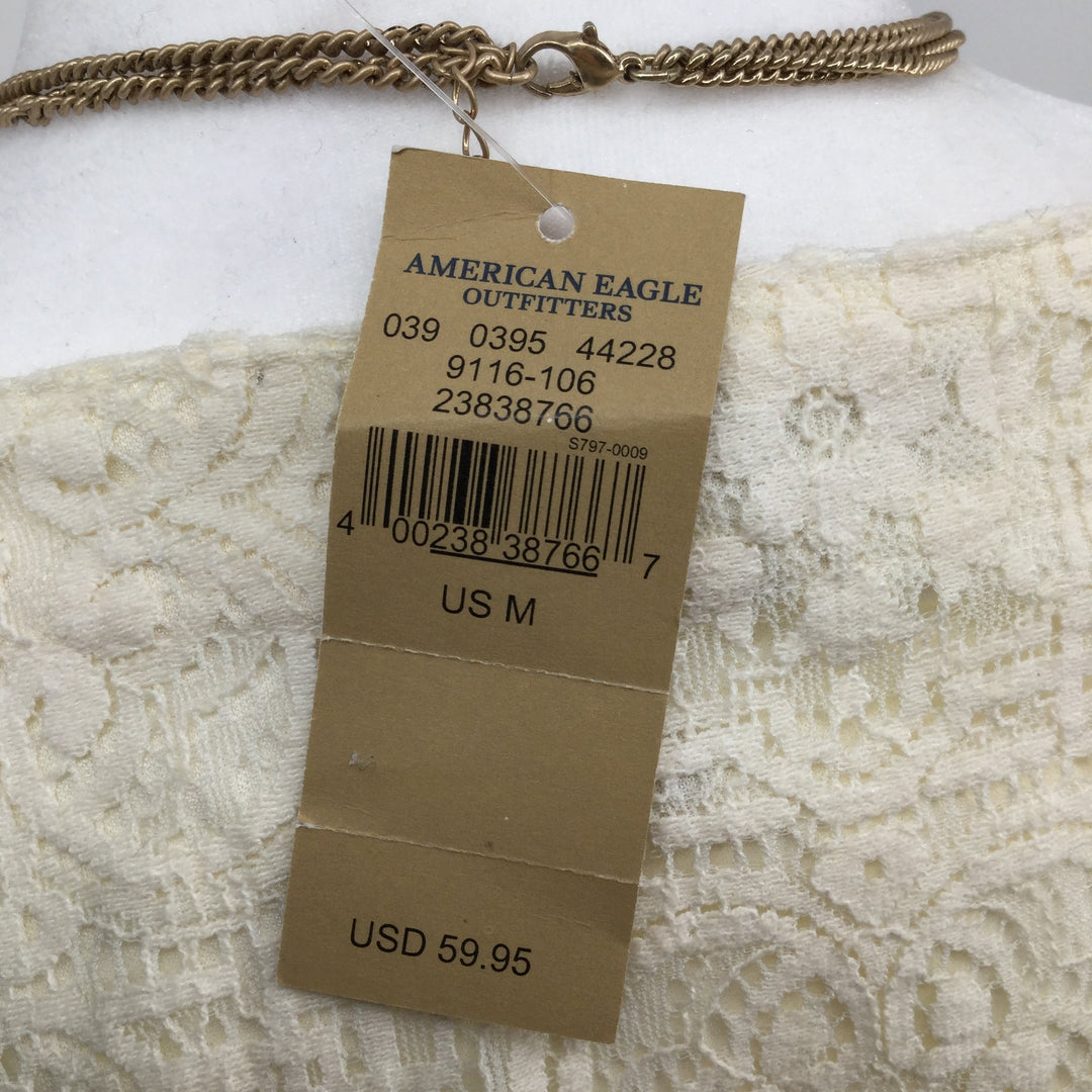 AMERICAN EAGLE DRESS SHORT LS SIZE:M - <P>IVORY LACE DRESS WITH IVORY LINING. TIE-UP FRONT. ELASTIC WAIST. SIZE M. COTTON AND NYLON.</P>