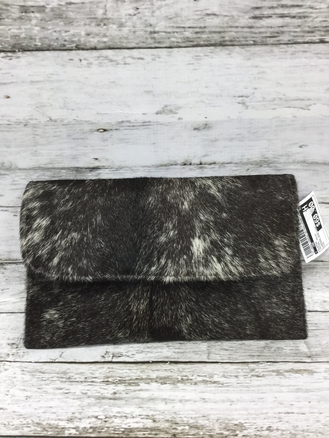 Photo #1 - BRAND:    CMD , STYLE: CLUTCH , COLOR: ANIMAL PRINT , OTHER INFO: JACKSON AND HYDE - , SKU: 127-4942-3369, , THIS CLUTCH IS HAIR-ON COWHIDE EXTERIOR WITH BLUE SUEDE INSIDE. IT CLOSES MAGNETICALLY. IT'S IN GREAT CONDITION AND COMES WITH A SLEEPER BAG!
