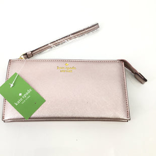 Kate Spade Pink Leather Clutch NEW! - NEW WITH TAGS! LIGHT PINK KATE SPADE CLUTCH WITH GOLD DETAILING. INTERIOR HAS BLACK AND WHITE VERTICAL STRIPS WITH THREE SEPARATE SECTIONS. MULTIPLE SMALLER POCKETS INSIDE AS WELL AS CARD SLOTS. STYLE IS MARYANNE..