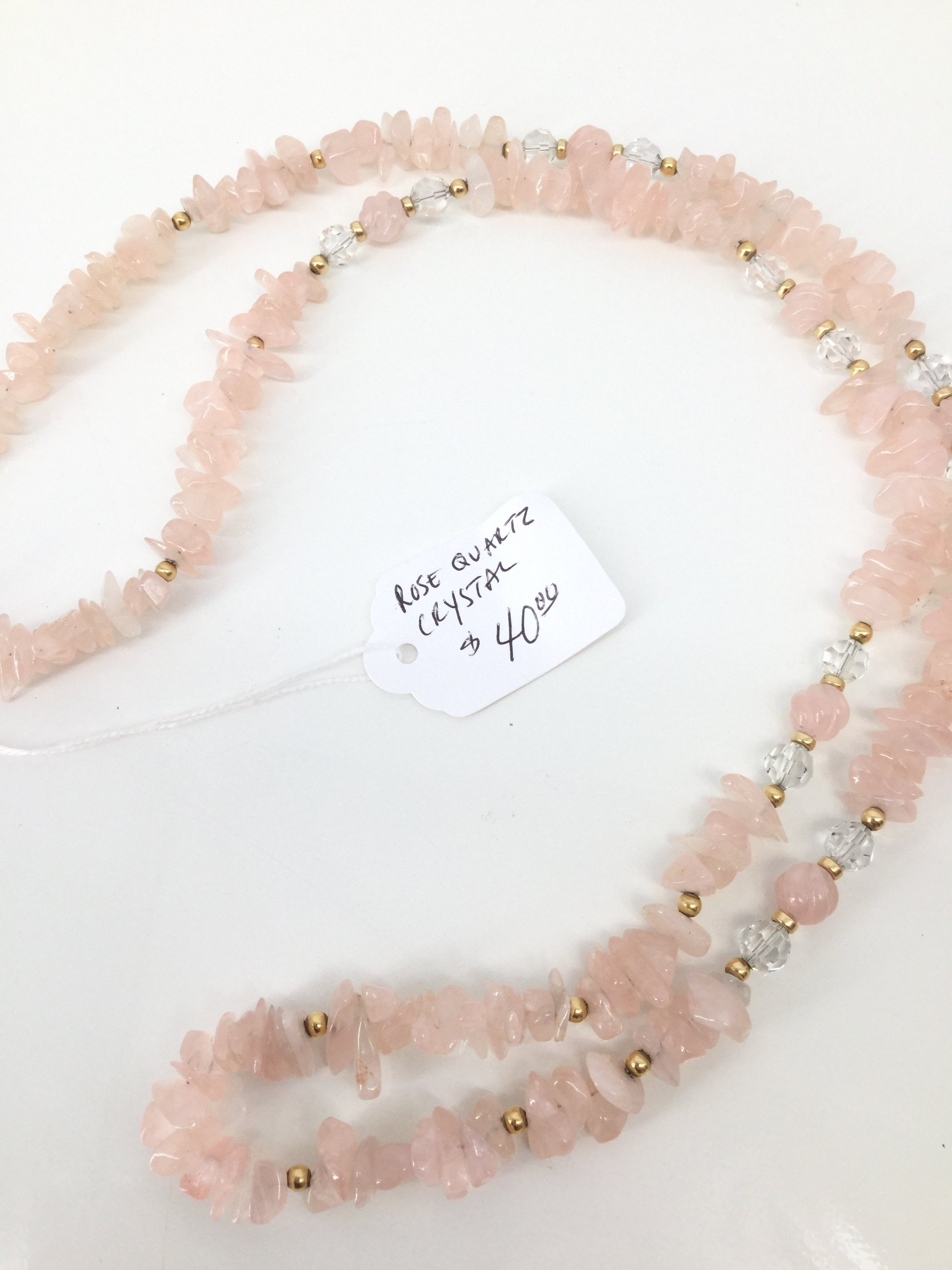 Cmd Necklace - <P>NEW! LONG ROSE QUARTZ CRYSTAL NECKLACE. PINK WITH CLEAR BEADS AND SMALL GOLD BEADS AS WELL. GOLD TWIST CLOSURE.</P>
