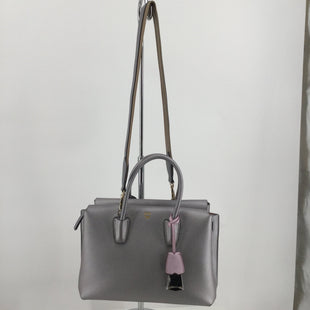 MCM Grained Calfskin Mini Milla Tote Spike Silver - THIS STYLISH TOTE IS CRAFTED OF GRAINED CALFSKIN LEATHER IN SILVER. THE SHOULDER BAG FEATURES ROLLED LEATHER HANDLES, AND AN OPTIONAL ADJUSTABLE SHOULDER STRAP. THE TOP HAS A CENTRAL ZIPPER COMPARTMENT AND THE SIDE COMPARTMENTS HAVE A FOLD OVER FLAP WITH MAGNETIC CLOSURE, OPEN EACH COMPARTMENT TO REVEAL A PINK MICROFIBER INTERIOR. THIS IS AN IDEAL EVERYDAY TOTE. THE CORNERS HAVE A LITTLE LOVE TO THEM AND ONE OF THE STRAPS. ALL AN ALL THIS IS A BEAUTIFUL TOTE..