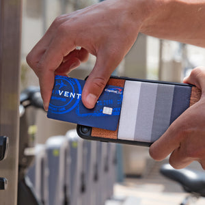 Man putting credit card into elastic pocket of JIMMYCASE iPhone Wallet Case