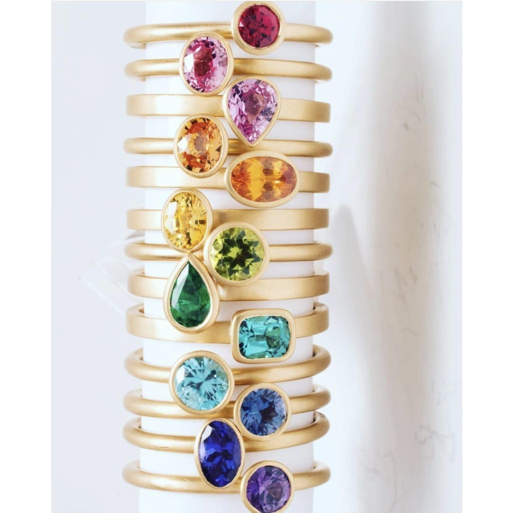18k Matte Yellow Gold Yumdrop Ring with a Oval Blue Topaz by