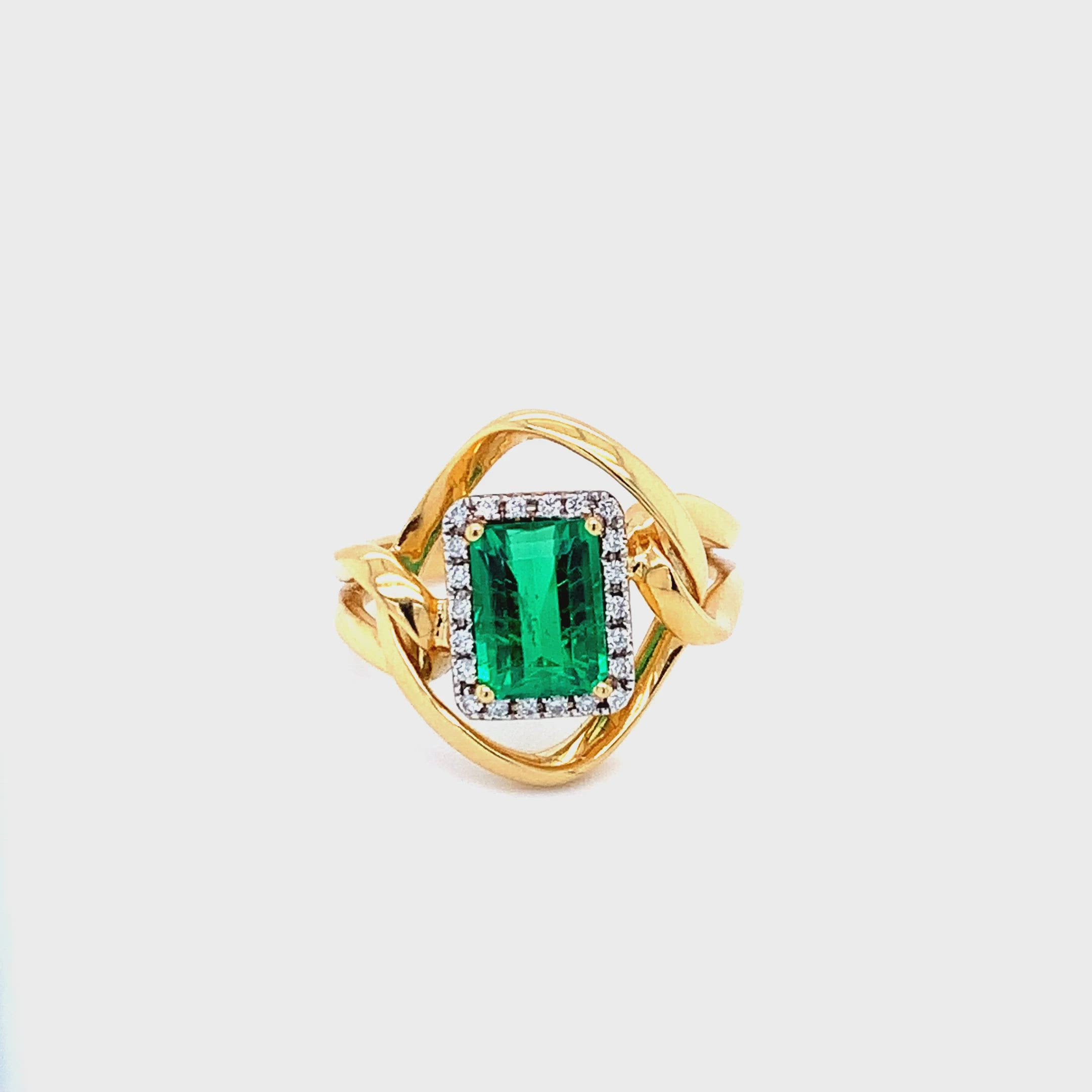 18K YELLOW GOLD WITH A 1.47CT EMERALD AND DIAMONDS IN AUSTIN, TX.