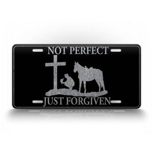 Western Cowboy Kneeling At a Cross With The Text Not Perfect Just Forgiven License Plate