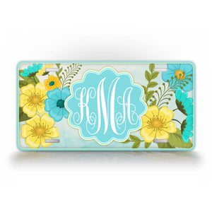 Custom Vibrant Blue And Yellow Flower monogram License Plate