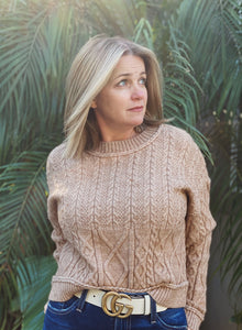 Caramel/ light brown colored sweater with cable knit pattern and a mock neck. This sweater is comfortable, on trend and in season.