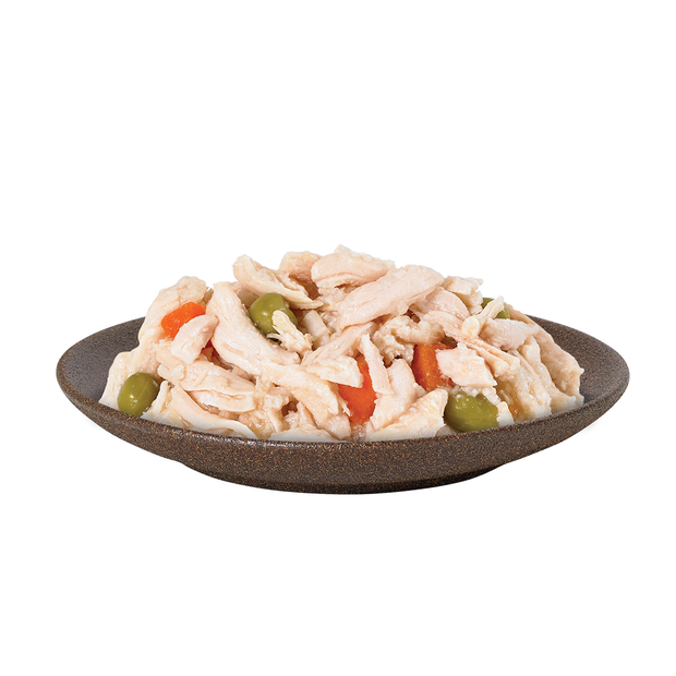 Delicious looking bowl of HiLife its only natural Luxury Chicken Breast with Carrots and Peas in Jelly wet dog food, showing real pieces of chicken breast, carrots and peas, made with 100 percent natural ingredients and 60% meat