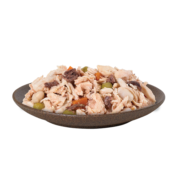 Bowl of HiLife its only natural Luxury Chicken Breast with tuna, beans and vegetables in broth wet dog food pouch, made with 100 percent natural ingredients, with visible high quality chicken, tuna, beans, carrots and beans