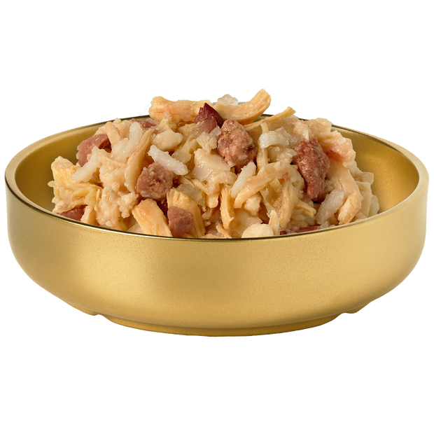 Bowl of HiLife Banquet Flaked Chicken with Rice and Liver Dog Food showing flakes of real chicken, rice and liver