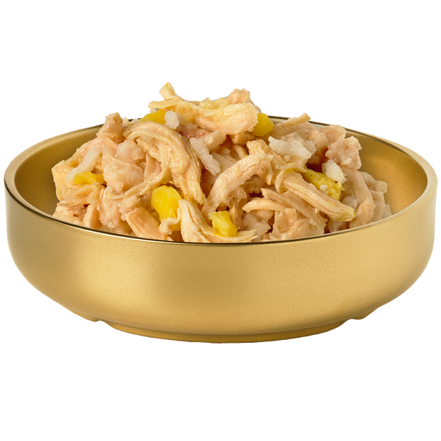 Bowl of HiLife Banquet Flaked Chicken with Rice and Pumpkin Dog Food showing flakes of real chicken, rice and pumpkin