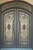 SEQUOIA- double arch top transom, bug screens, front entry wrought iron doors-62x96 Right Hand