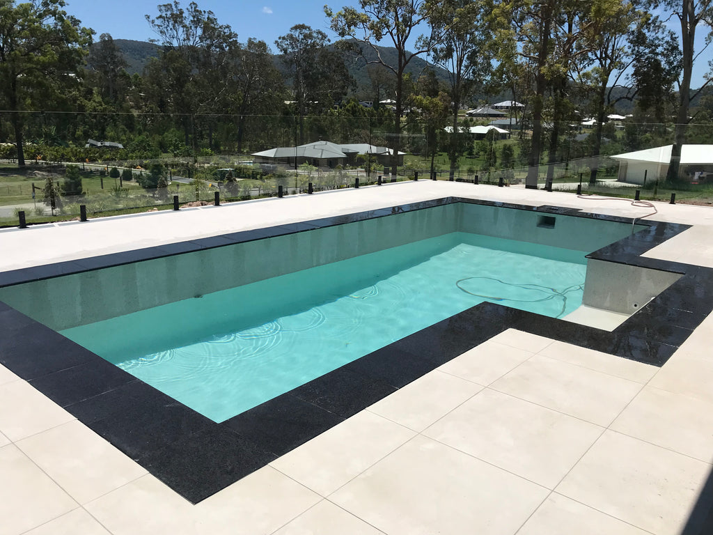 Amic Pools latest swimming pool combined with the new Poolrite Composite Spigot for frameless glass fencing.
