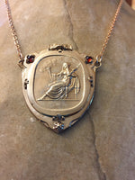 Vesta Goddess Pendant Necklace Bronze 1.5 Inches Wide 2 Inches Long 2 Rose-cut Garnets .60 Ctw 25 Grams Sterling Silver 16 Inches Long