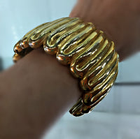 Givenchy Cuff Bracelet Gold Plated Wave-Like Pattern Signed Plaque 72 Grams 1 7/8 Inches Wide 6 3/8 Inches Long
