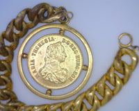 Maria Theresia Thaler Token Charm on Rolled Gold Plated Hollow Charm Bracelet 1 3/4 Inches Round Curb Chain 6 mm Thick 1/2 Inch Wide 7 1/2 Inches Long