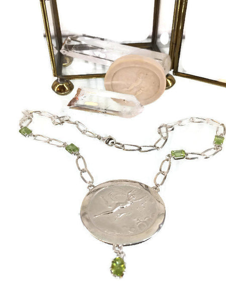 Aurora Mythological Pendant Single Strand Necklace Sterling Silver 1 1/2 Inches Wide 1 3/8 Inches Long 5 Peridot Gemstones 4 Emerald Cut 1 Oval 4.5 tcw 28 Grams 15.5 Inches Long