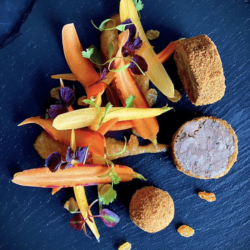 Roulade of confit duck & duck liver bon bon with Pain d'épices crumb- heritage carrot salad, Golden raisin purée