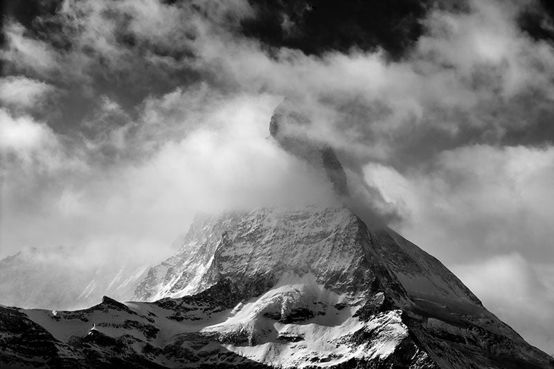 The Matterhorn with clouds swirling about it's snow-covered flanks