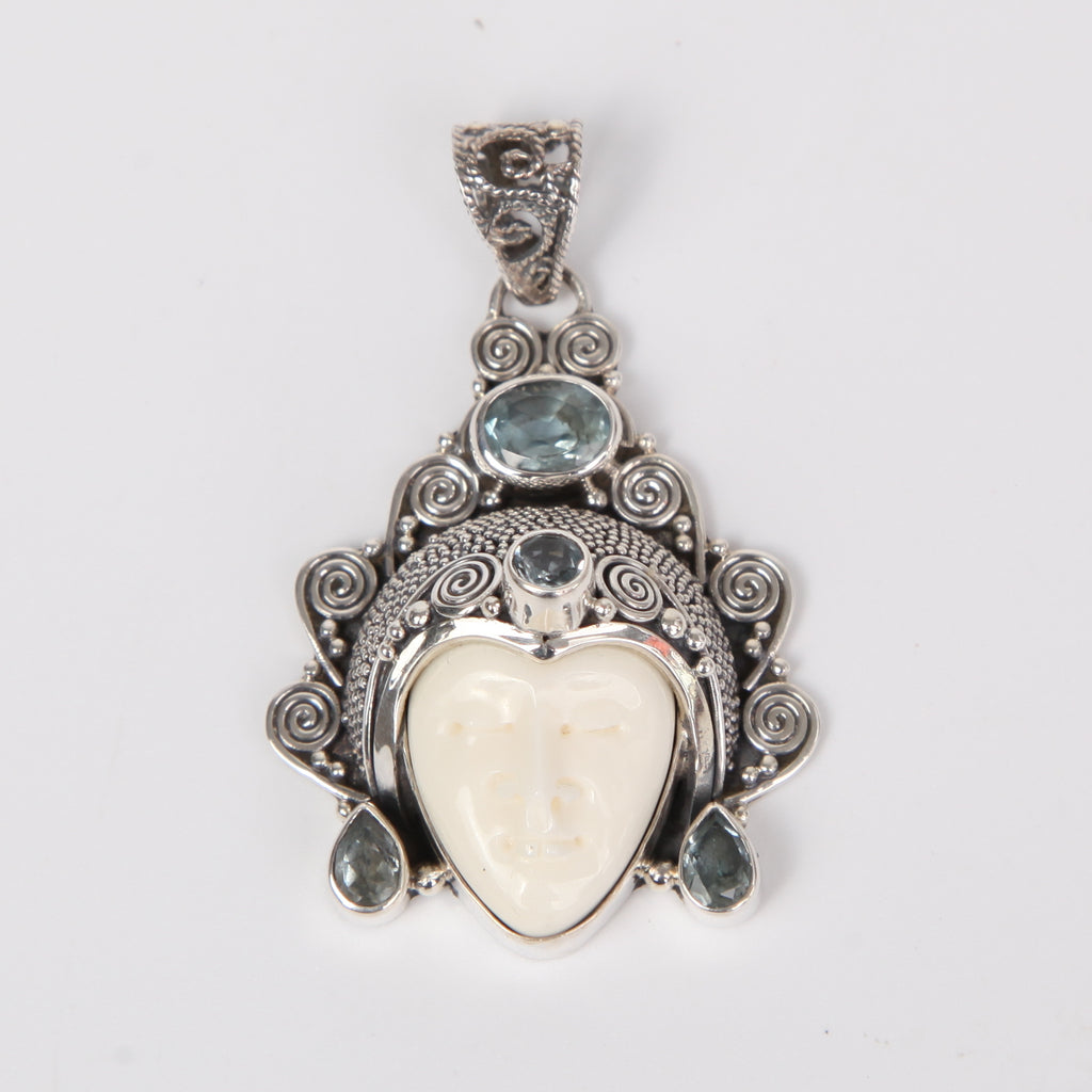 Buffalo Bone (Moon face) Sterling Silver Pendant with Blue Topaz
