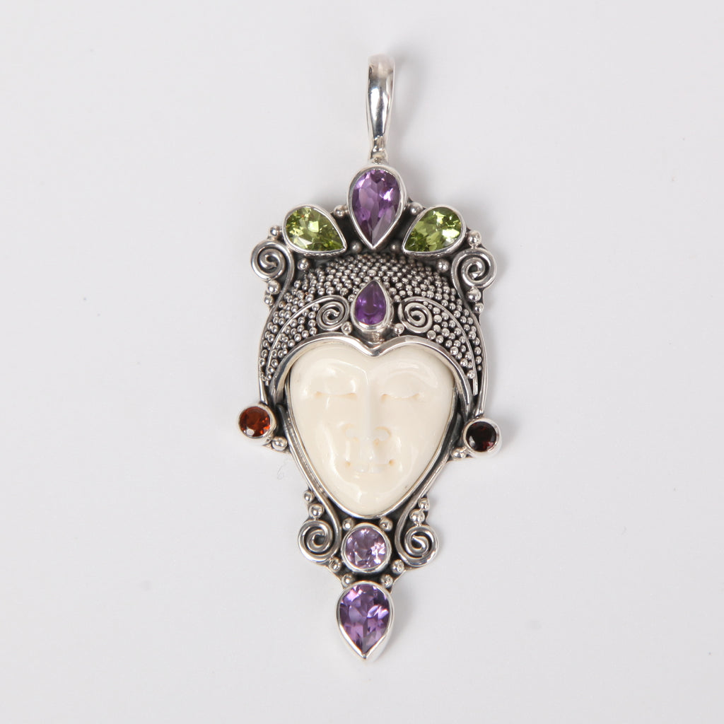 Buffalo Bone (Moon face) Sterling Silver Pendant with Amethyst, Peridot and Garnet.