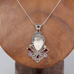 Buffalo Bone (Moon face) Sterling Silver Pendant with Garnet, Amethyst and Peridot
