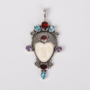 Buffalo Bone (Moon face) Sterling Silver Pendant  with Garnet, Blue Topaz and Amethyst