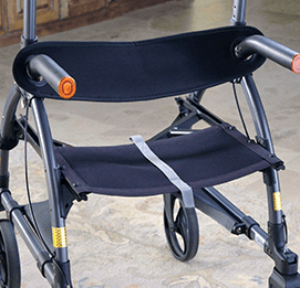 A detachable walker backrest support connected to an UPWalker upright walker.