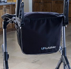 Luxury UPWalker-branded personal item bag connected to the front of an upright walker, on the opposite side of the seat.