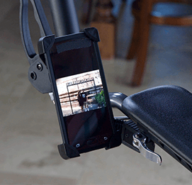 A close up of a Samsung smartphone connected to the arm of an UPWalker through the use of a walker phone holder attachment.