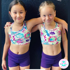 owlete active graffiti design crop top in a set with deep purple shorts