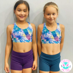owlete active tropical crop top in a set with plain coloured shorts