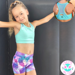 owlete active mint green crop top for girls with beautiful strap details in a set with tropical shorts