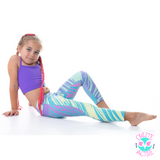 owlete active wild rainbow tights with swirly pastel colours for young sport loving girls in a set with purple crop top